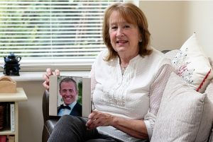 carol-donaldson-with-a-picture-of-her-son-james